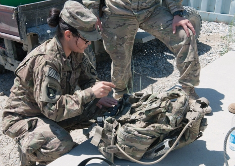 : Spc. Bianca Beck, 1st Brigade Combat Team, 101st Airborne Division, secures equipment to her body armor at Forward Operating Base Fenty, Nangarhar Province, Afghanistan. (Credit: U.S. Army/Sgt. Margaret Taylor)