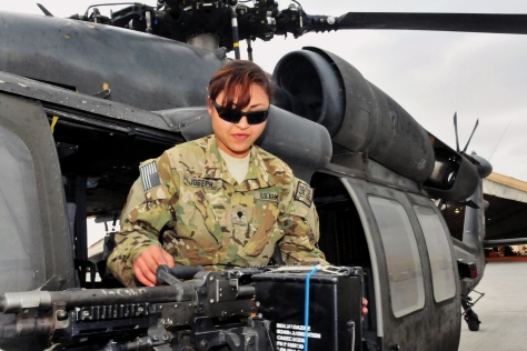 Spc. Shaina Joseph, a chemical, biological, radiological and nuclear specialist with the 101st Airborne Division's 1st Brigade Combat Team, mounts her M240B machine gun aboard a UH-60 Black Hawk helicopter at Jalalabad Airfield in Afghanistan's Nangarhar Province. (Credit: U.S. Army/Sgt. 1st Class John D. Brown)